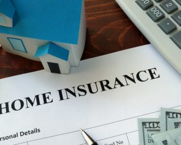 Home insurance form with model house and dollars on the side