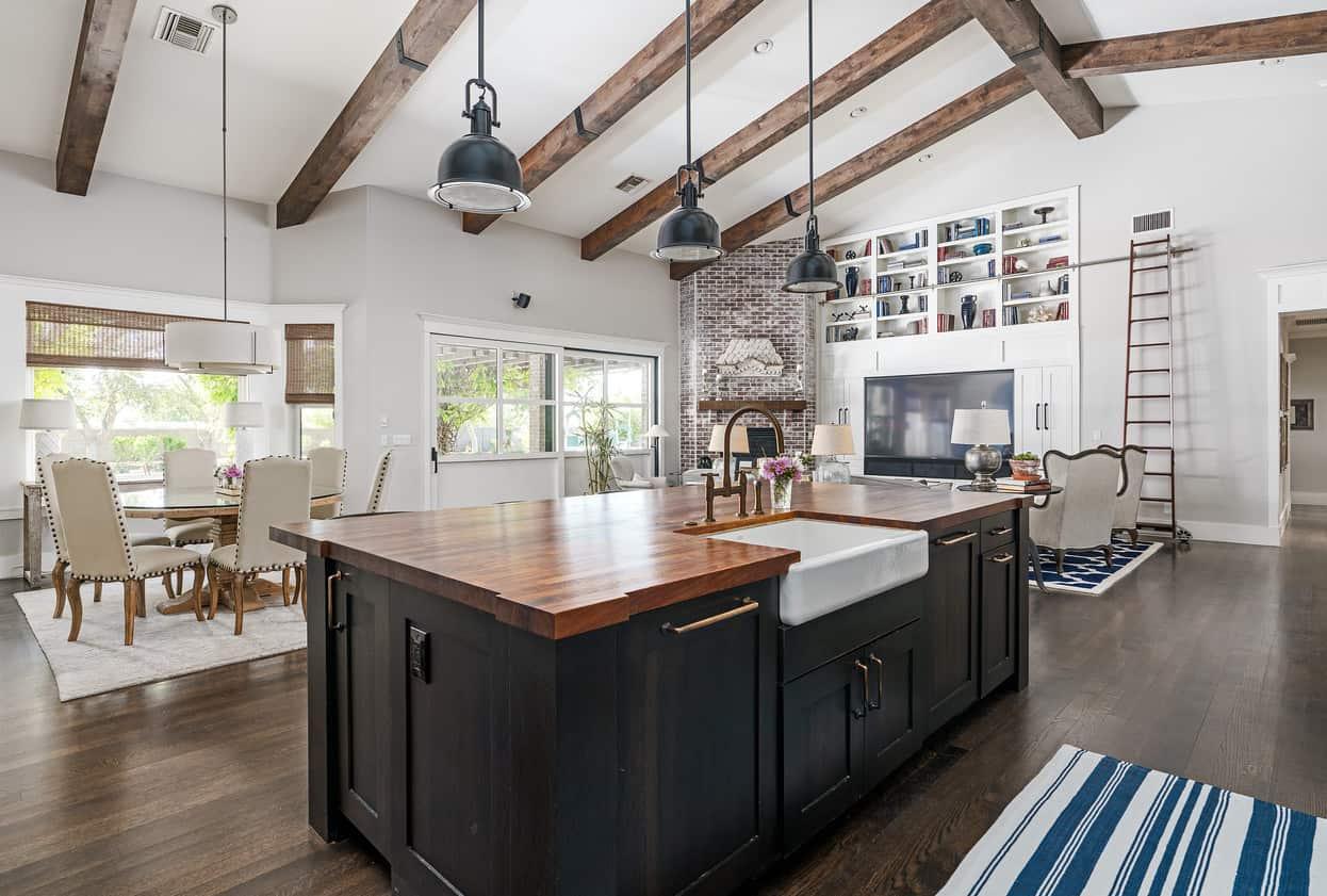 Open concept kitchen and living room with dark hardwood flooring