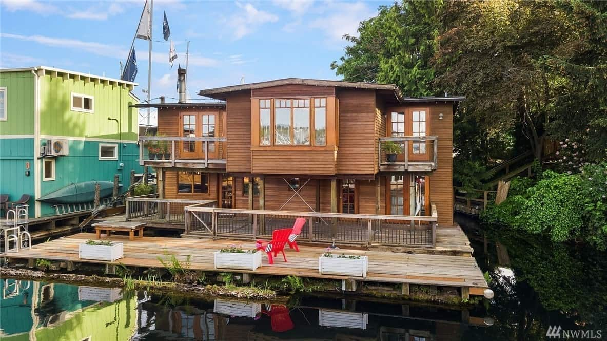 Craftsman style floating home with deck.