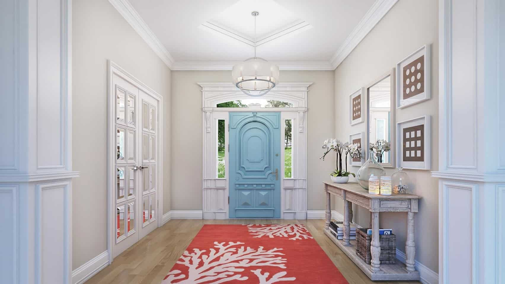 Neutral foyer accented with a pastel blue door and red runner that lays on hardwood flooring. It is designed with minimalist wall arts and white mirror mounted on the light gray wall.
