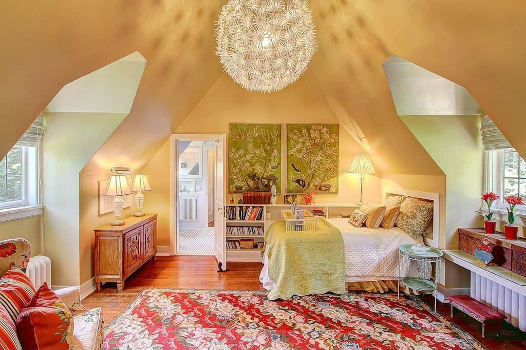 Kids bedroom surrounded with vaulted walls and lighted by a huge dandelion chandelier that hung from the marigold cathedral ceiling.