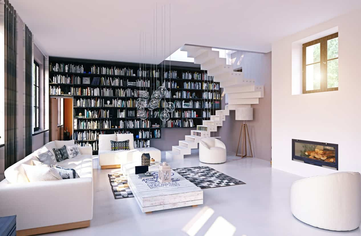 Stylish reading nook with a black bookshelf beside a modern white staircase lighted by clear glass globe pendants.
