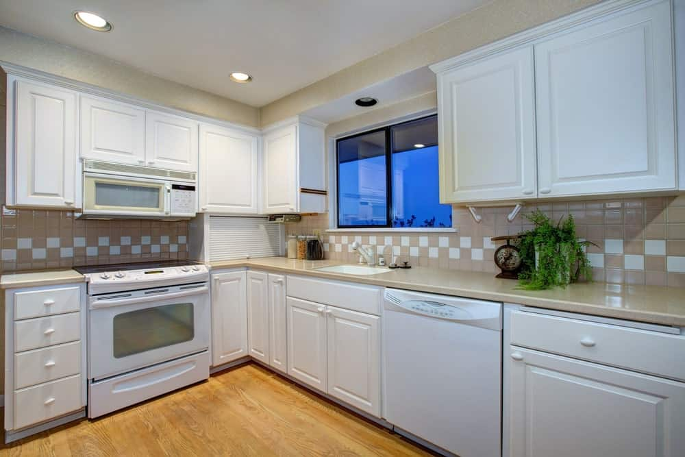 Kitchen with white shaker cabinets.