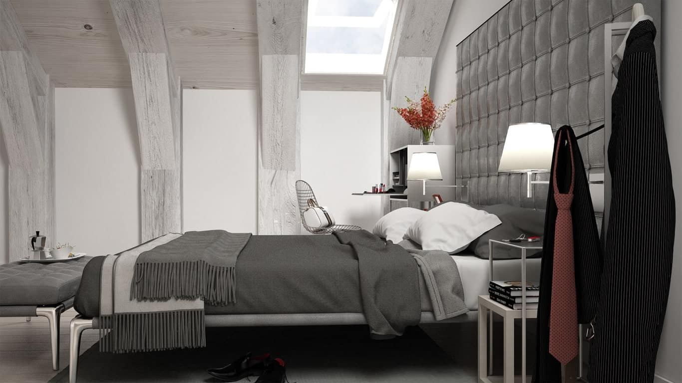 The gray cushioned headboard of the bed extends to the side to provide a nice background for the modern bedside tables that pair with the metallic frame of the bed and its matching cushioned bench at its foot.