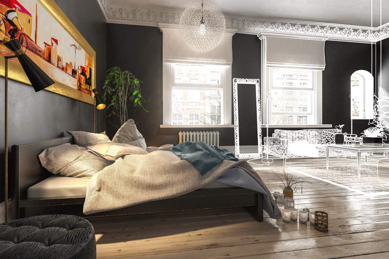 There is a colorful golden framed painting mounted on the black wall above the black wooden headboard of the platform bed that complements the light hardwood flooring adorned with fragrant candles.