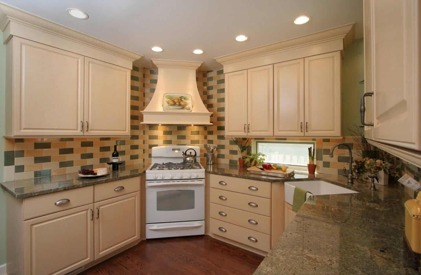 Marvelous kitchen styled with an eye-catching subway tile backsplash that goes well with the cream cabinetry and white range.