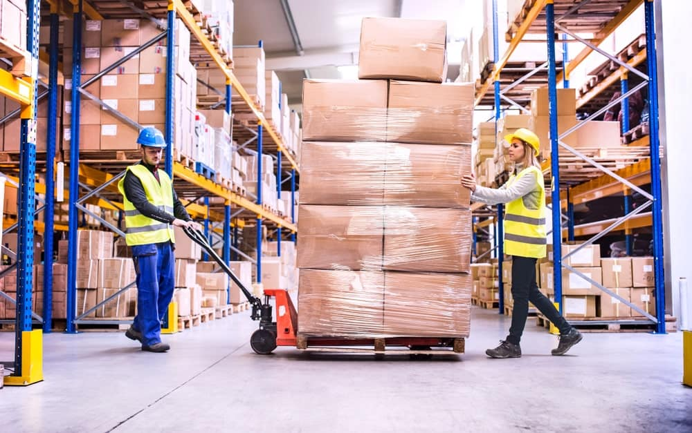 Warehouse Workers Pulling a Pallet Truck