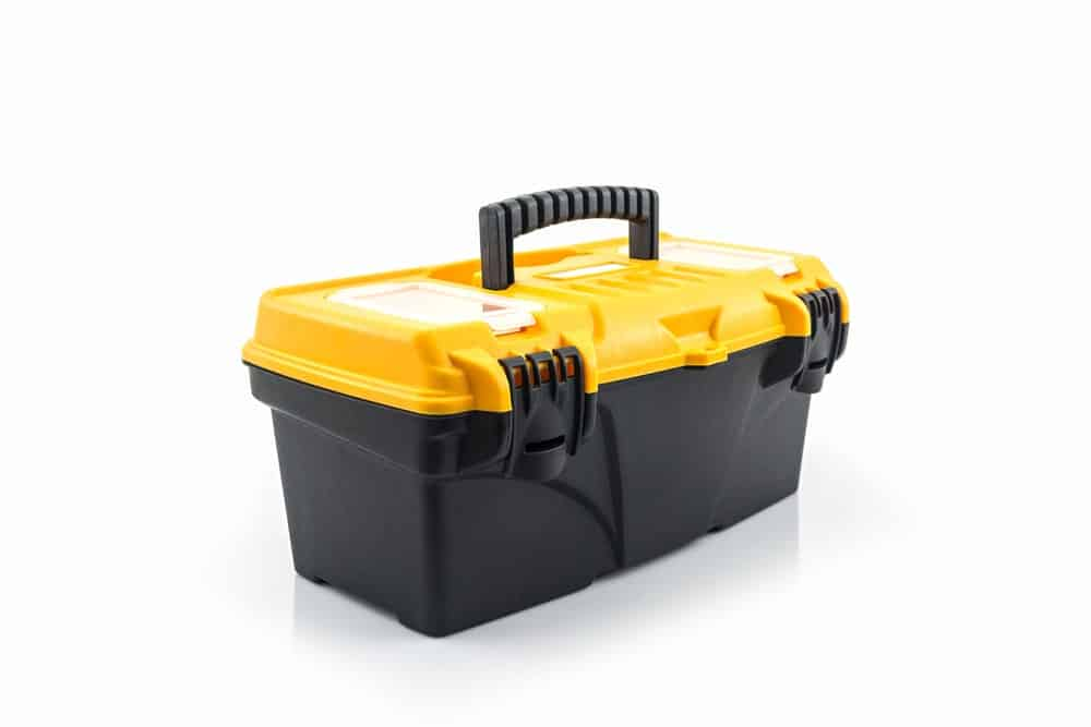 A plastic hand-carry toolbox