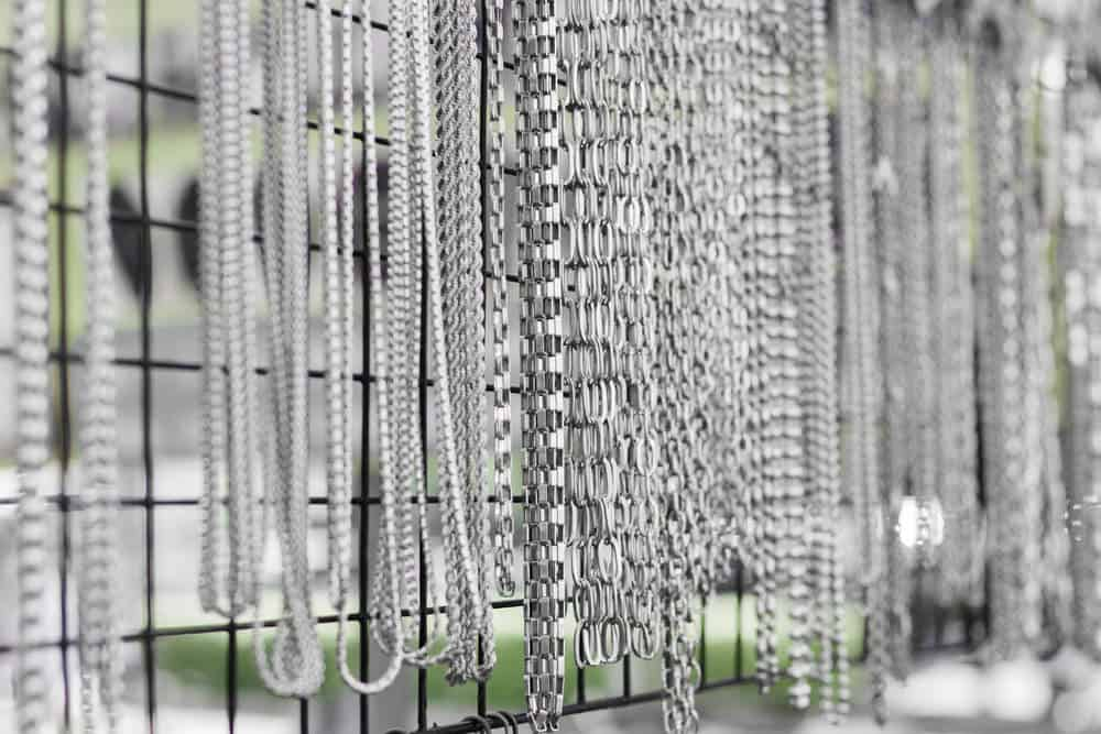 A wall of stainless steel jewelry