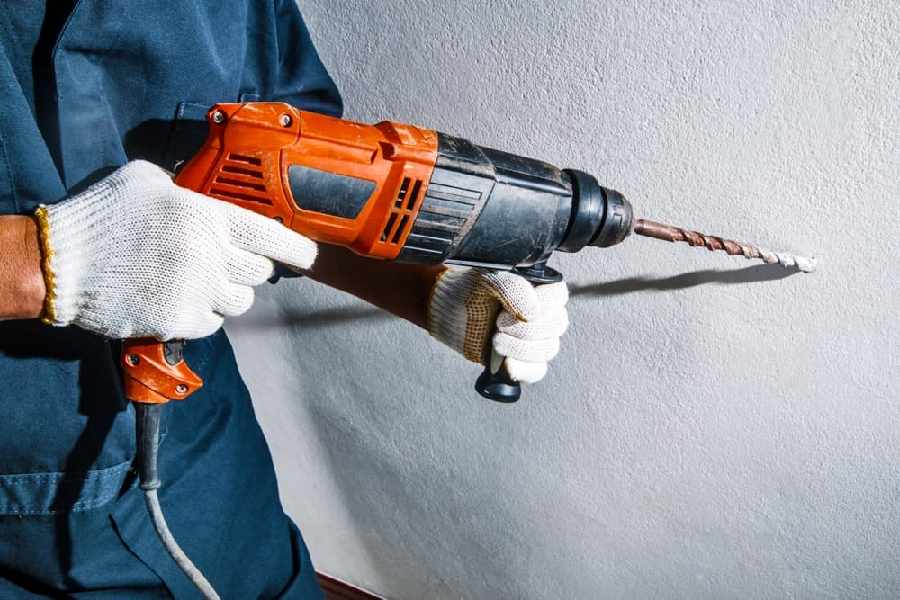 A Man with a Drill Machine