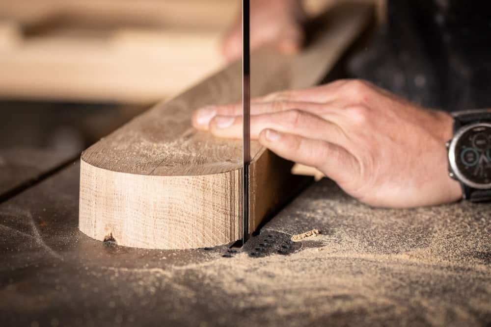 A Carpenter Using a Bandsaw