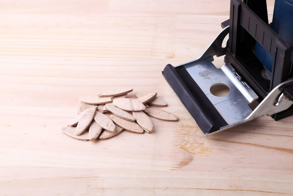 A Biscuit Joiner on a Wood Surface