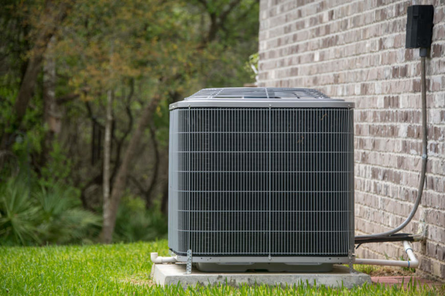 Central air condition unit outside of house