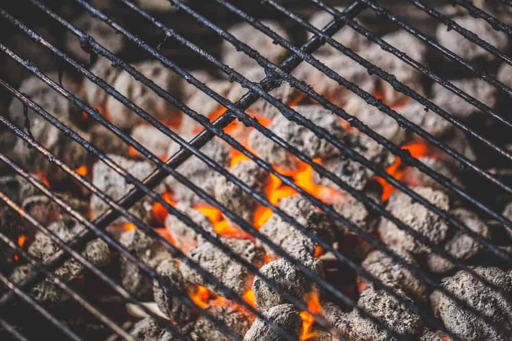Charcoal grill filled with fully heated charcoal