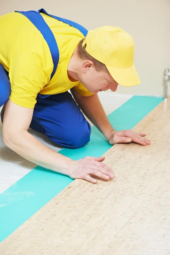 Carpenter protecting cork floor