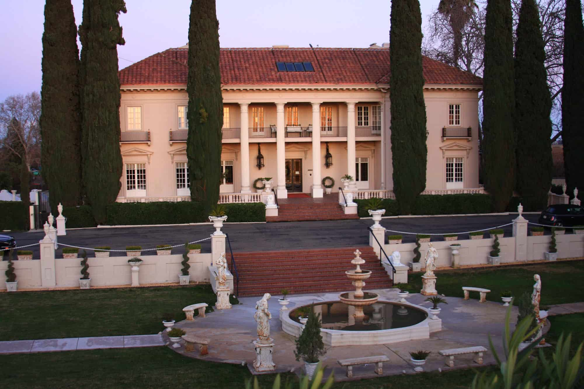 California Mansion and fountain at sunset