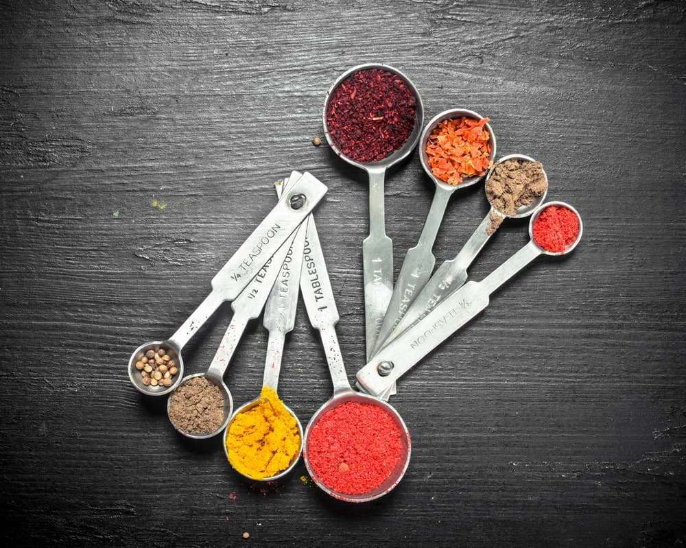 Measuring Spoons Filled with Ground Spices