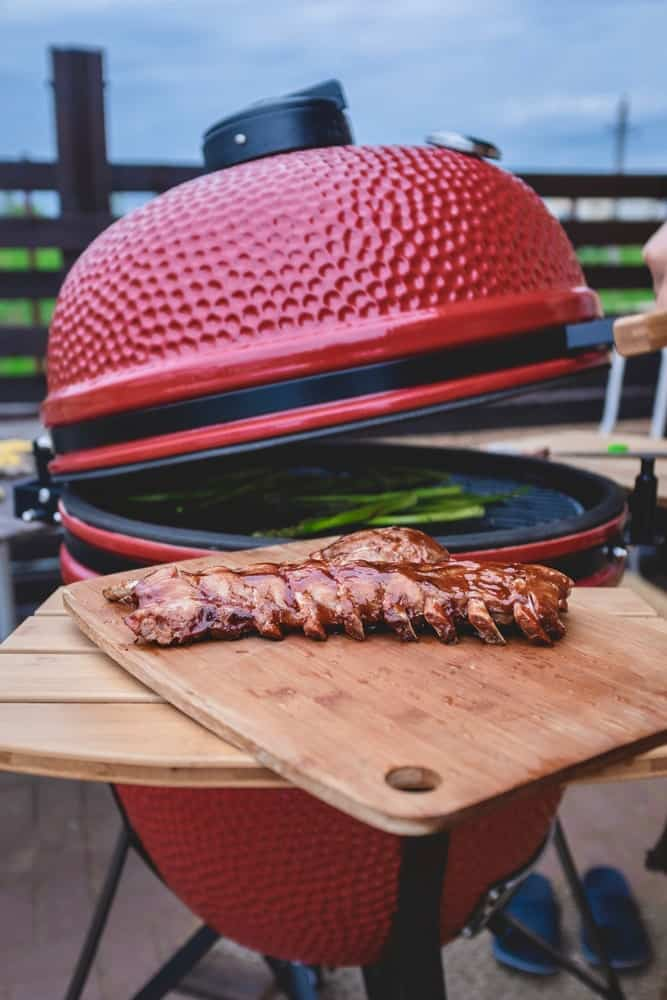 Red kamado grill for grilling meat