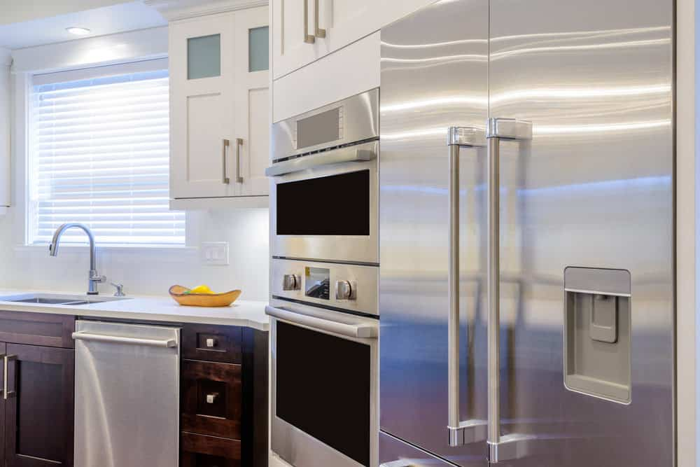 Kitchen with stainless steel fridge