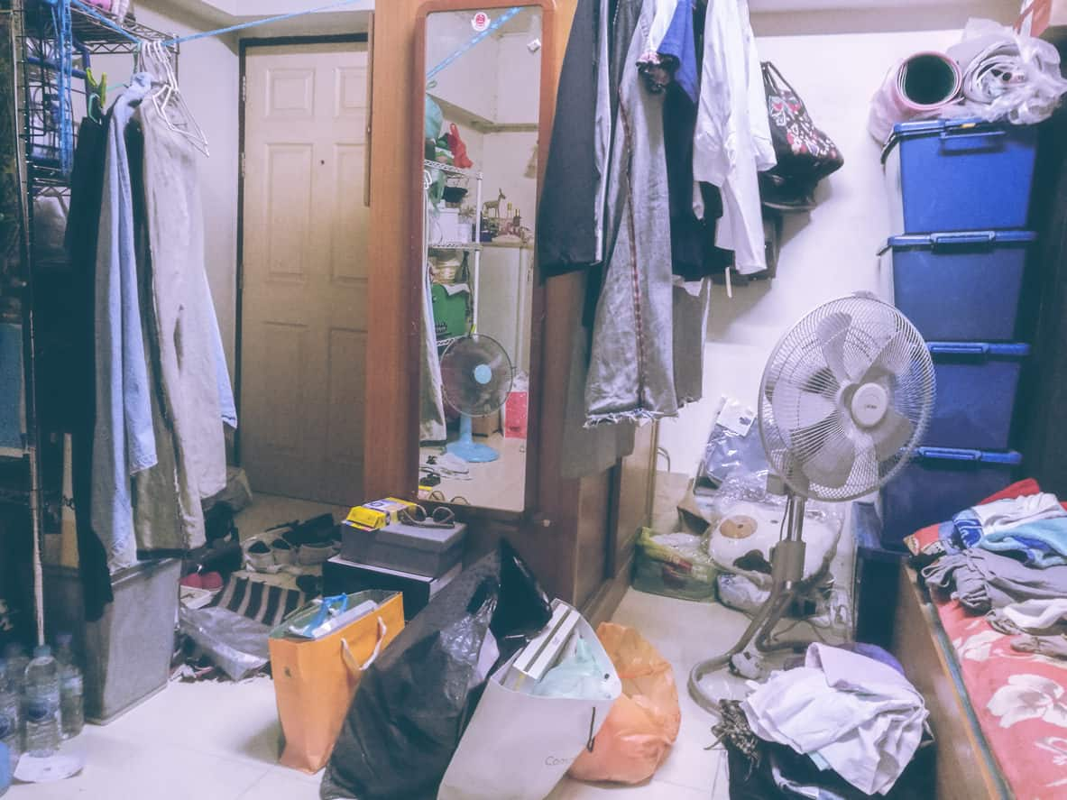 Messy bedroom with clutter everywhere