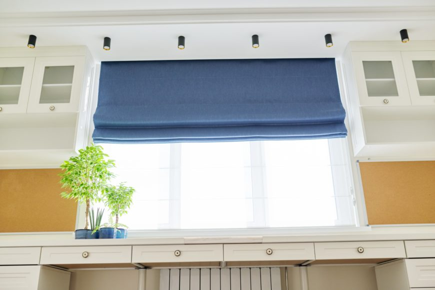 Sheer Blue Roman Style Blinds over Kitchen Sink
