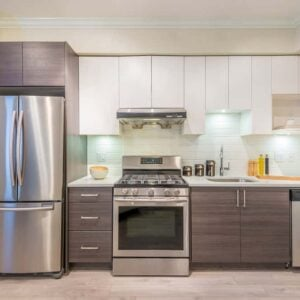 Small kitchen with clean stainless steel appliances