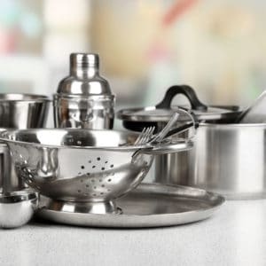 Stainless steel pans and cookware on counter