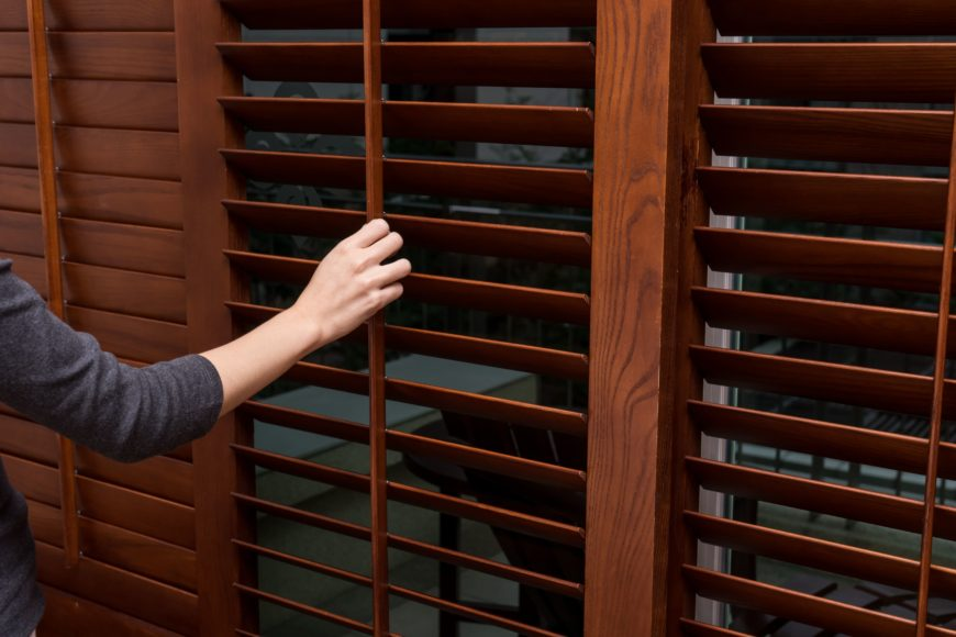 Wooden Shutters Horizontal Blinds Being Opened