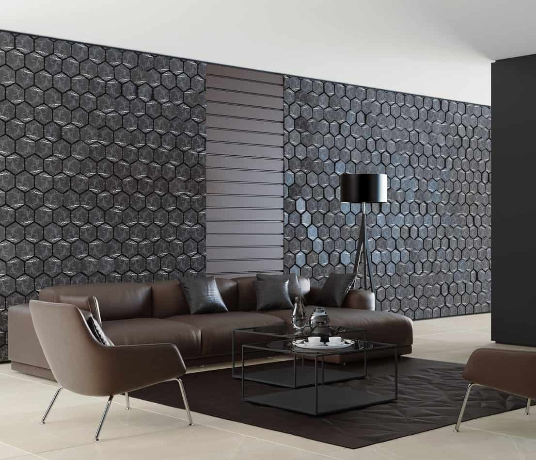 This living room offers a stylish wall design along with brown leather seats set on the large tiles flooring.