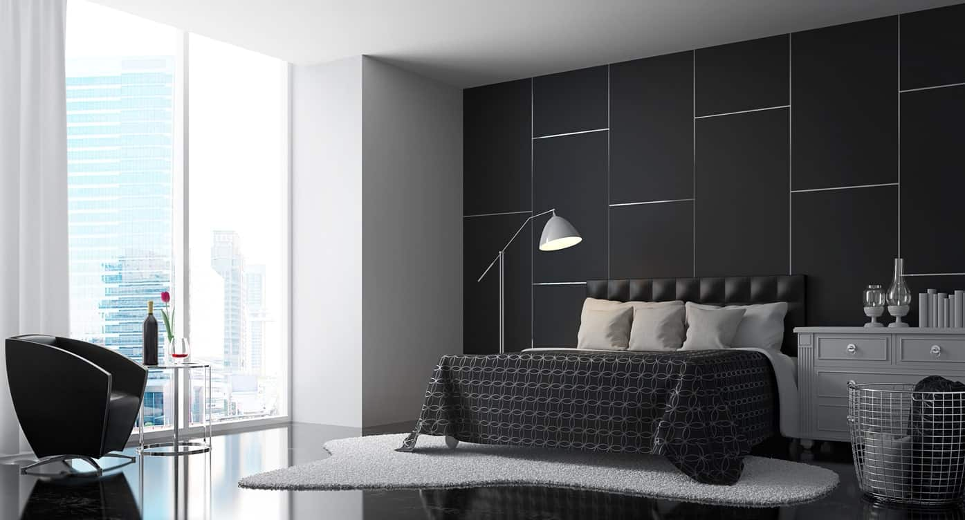 Modern master bedroom featuring black wall and floors, along with a black bed frame.