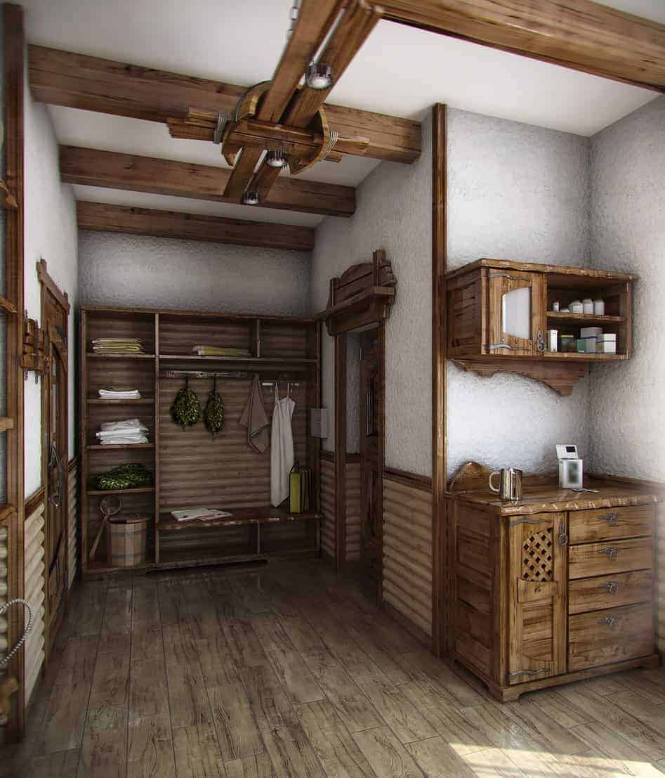 Rustic foyer with wooden storage cabinets and open shelving. It is illuminated by flush lights mounted on the wood beam ceiling.