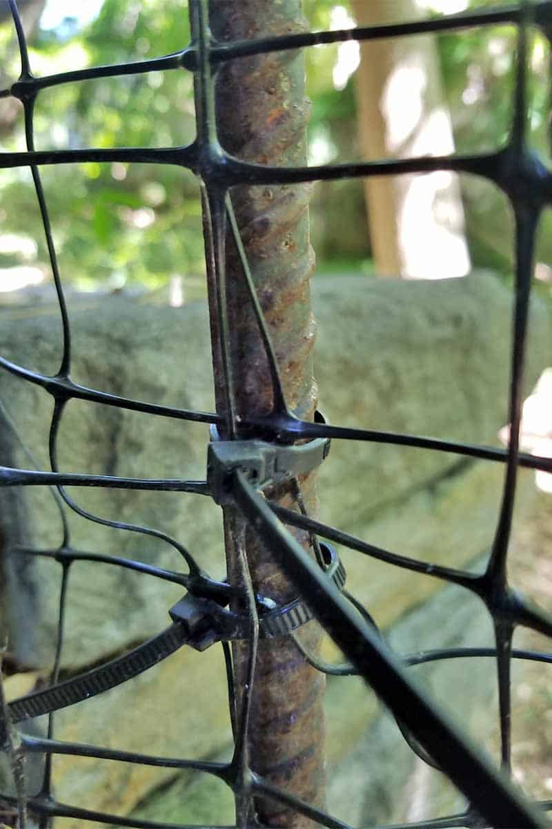 Chicken wire fence with a zip tie.