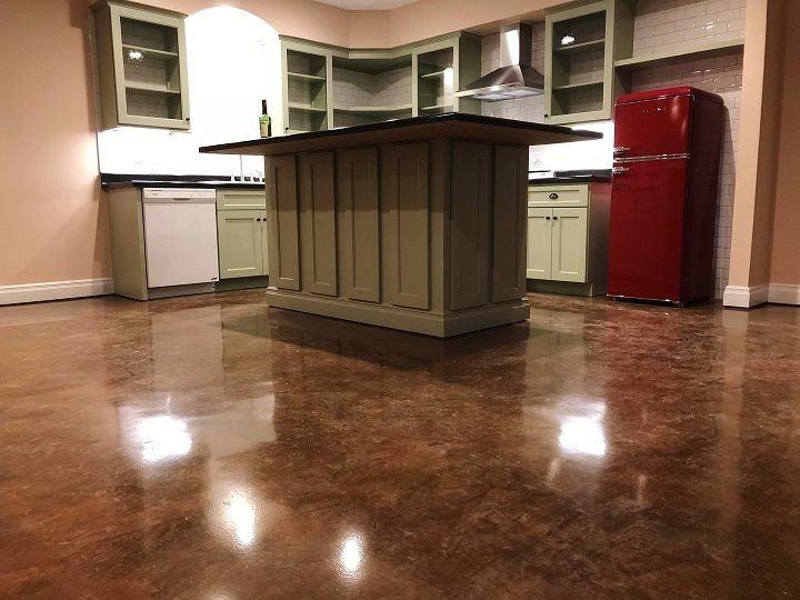 Kitchen with decorative concrete floor