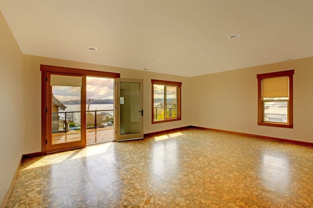 A bare room with cork flooring.