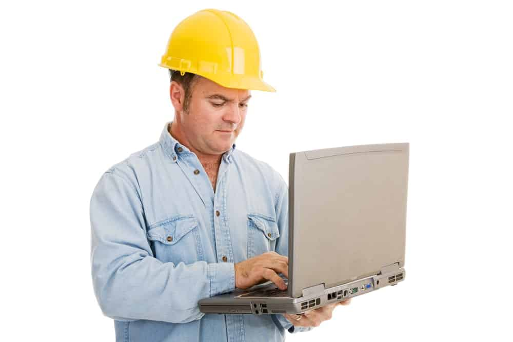 Electrician using a laptop.