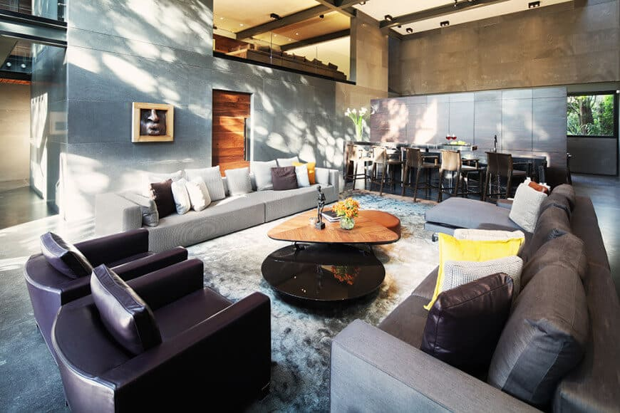 A great room featuring a nice set of seats along with a stylish center table set on the gray rug.