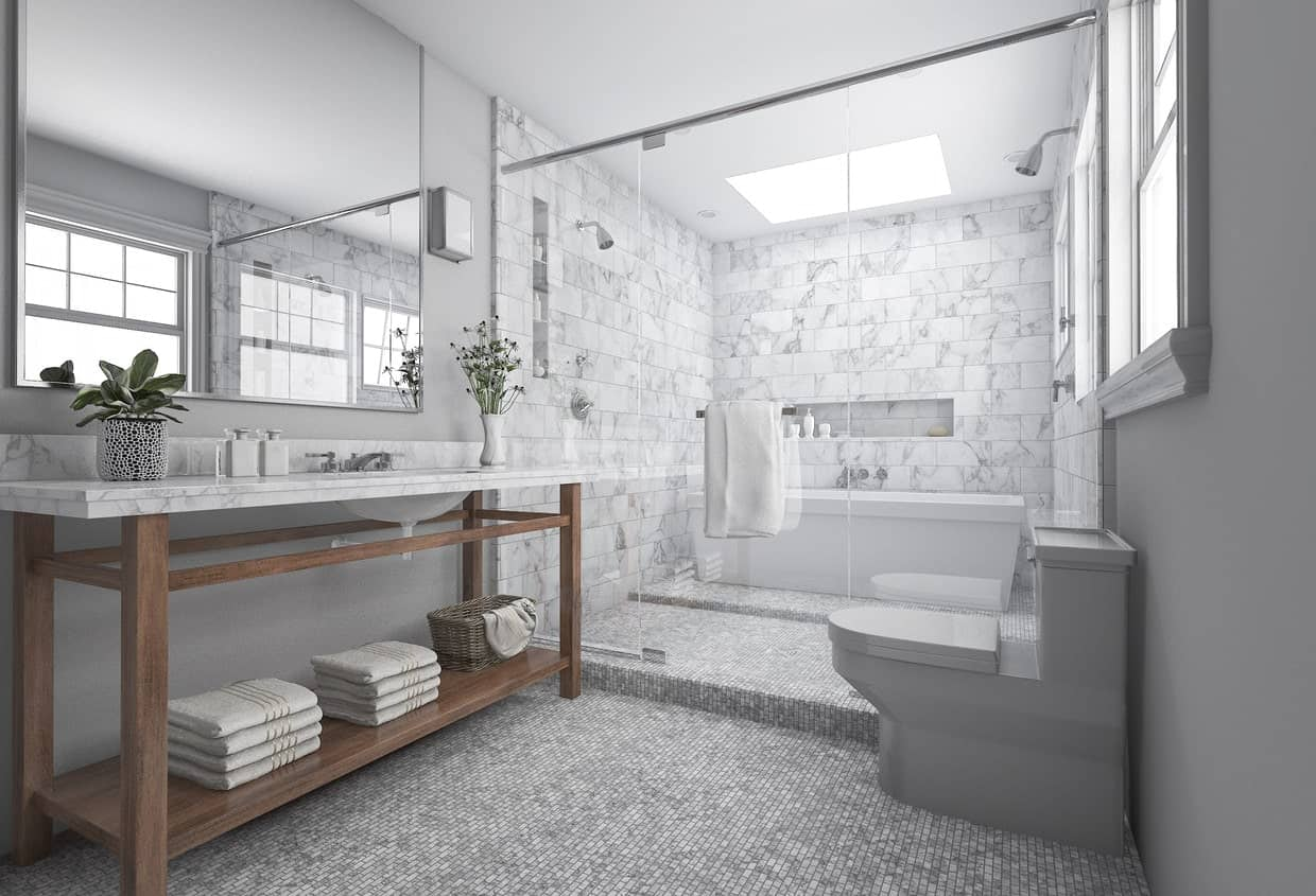 Gray master bathroom featuring micro tiles floors along with marble tiles walls in the shower and tub area.