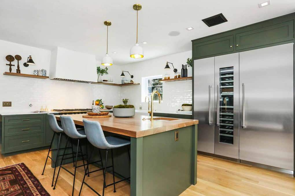 This kitchen features green kitchen counters and a green center island breakfast bar with a wooden countertop.