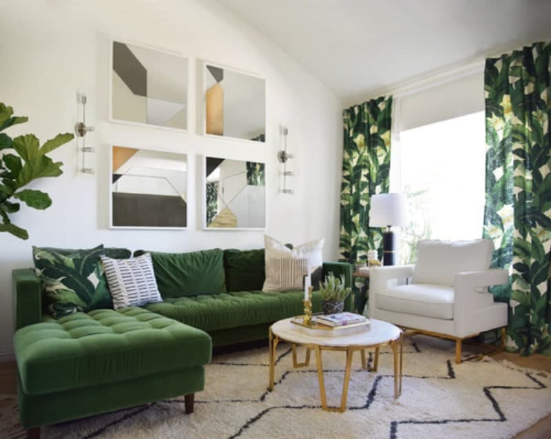 A nice-looking living room featuring a green L-shape sofa along with green window curtains surrounded by white walls.