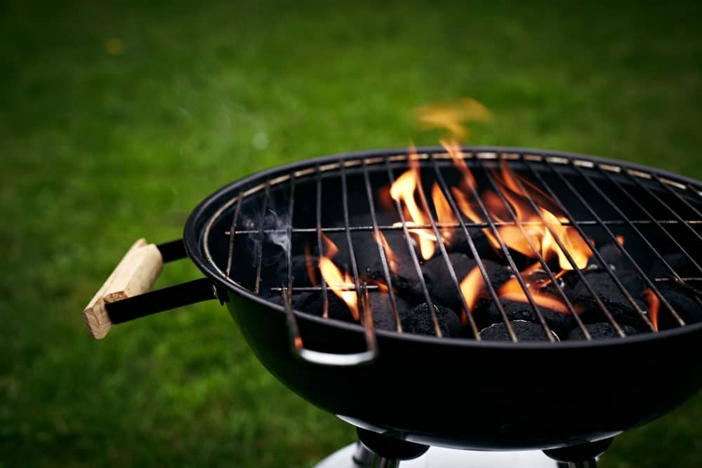 A barbecue grill with crackling fire.