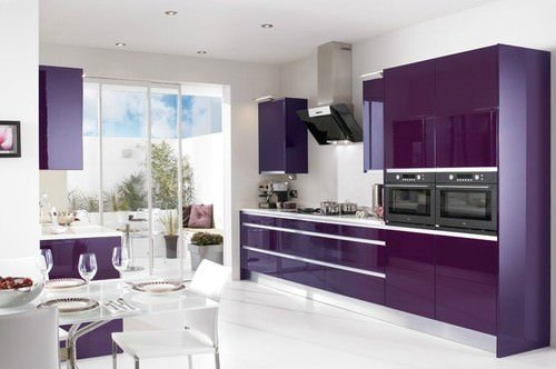 Modish kitchen with purple kitchen counters and cabinetry. The purple accent looks perfect together with the white flooring.