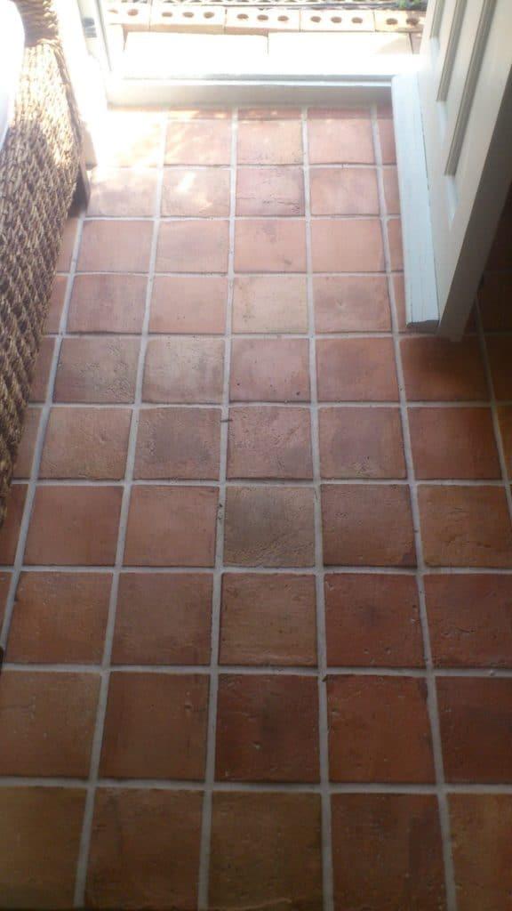 Terracotta brick tiles flooring on the home's doorway.