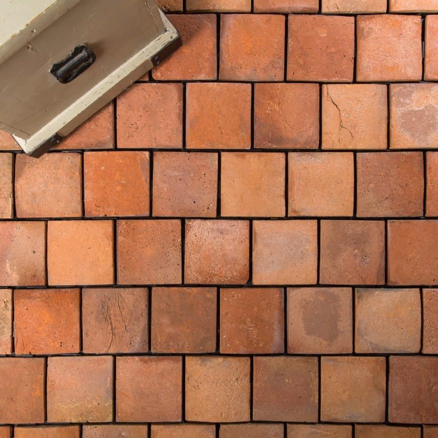 A nicely set reclaimed terracotta tiles flooring.