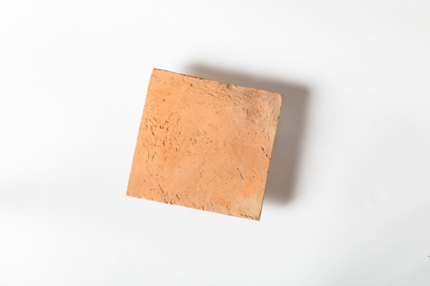 Another look at this single terracotta tile on a white background.