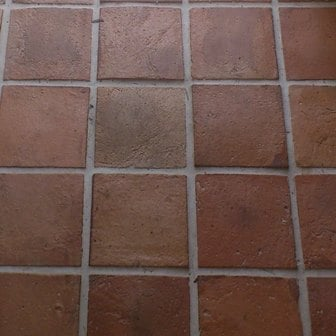 Close up look at this terracotta brick tiles flooring.