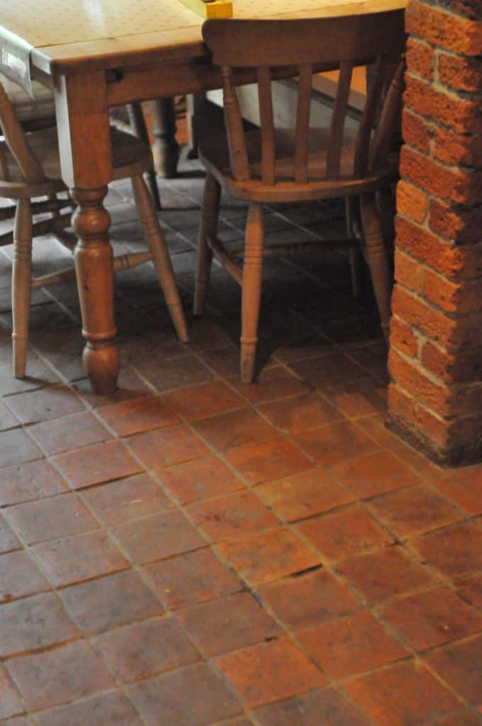 An outdoor dining and kitchen along with reclaimed terracotta tiles flooring.