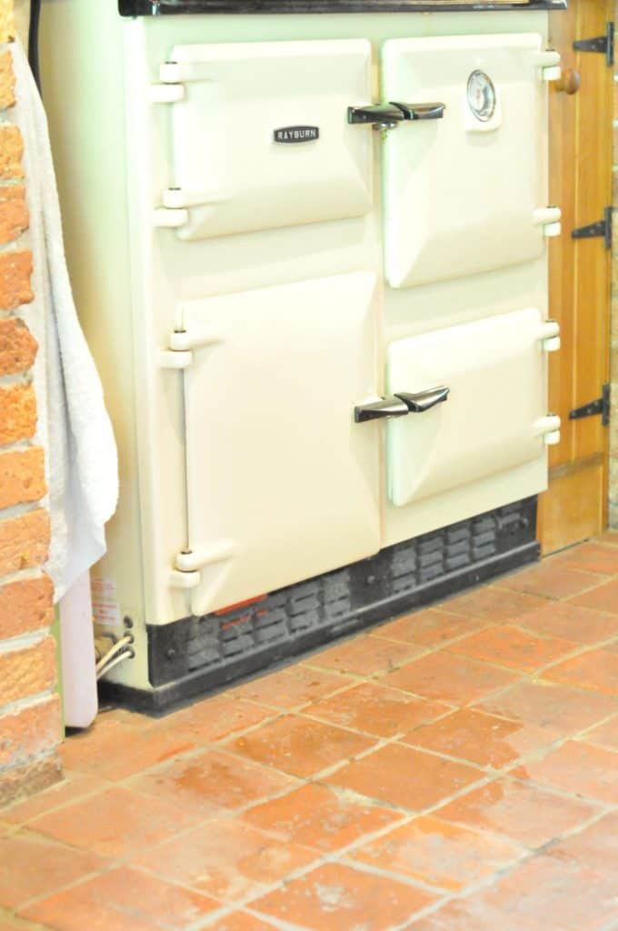 A reclaimed square terracotta tiles flooring.