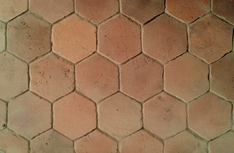 A close up look at this light-finished hexagonal terracotta tiles floors.