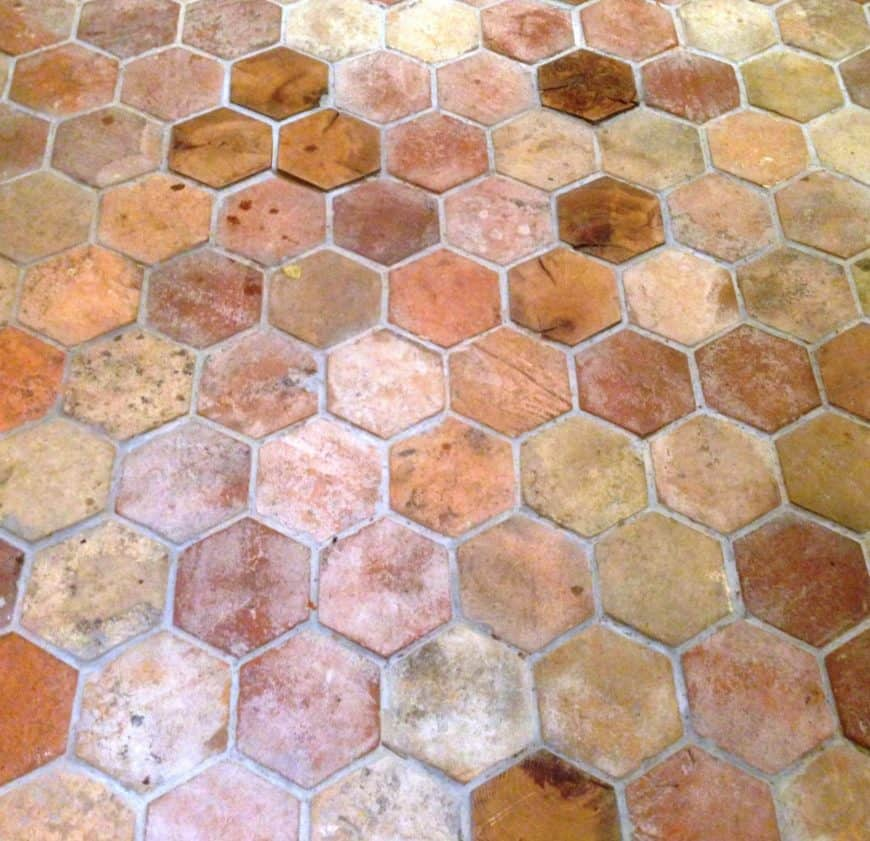 An outdoor hexagonal reclaimed terracotta tiles flooring with different finishes.
