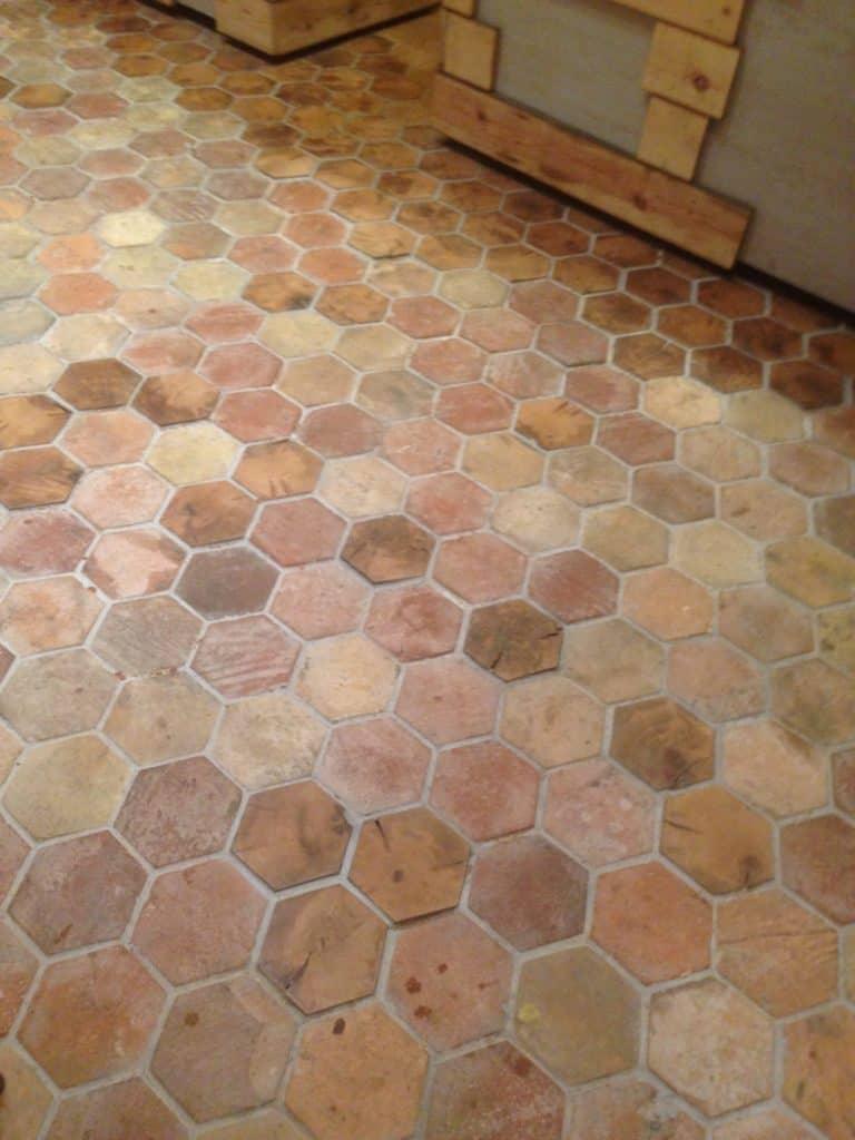 Hexagonal reclaimed terracotta tiles floors that look great in the kitchen.